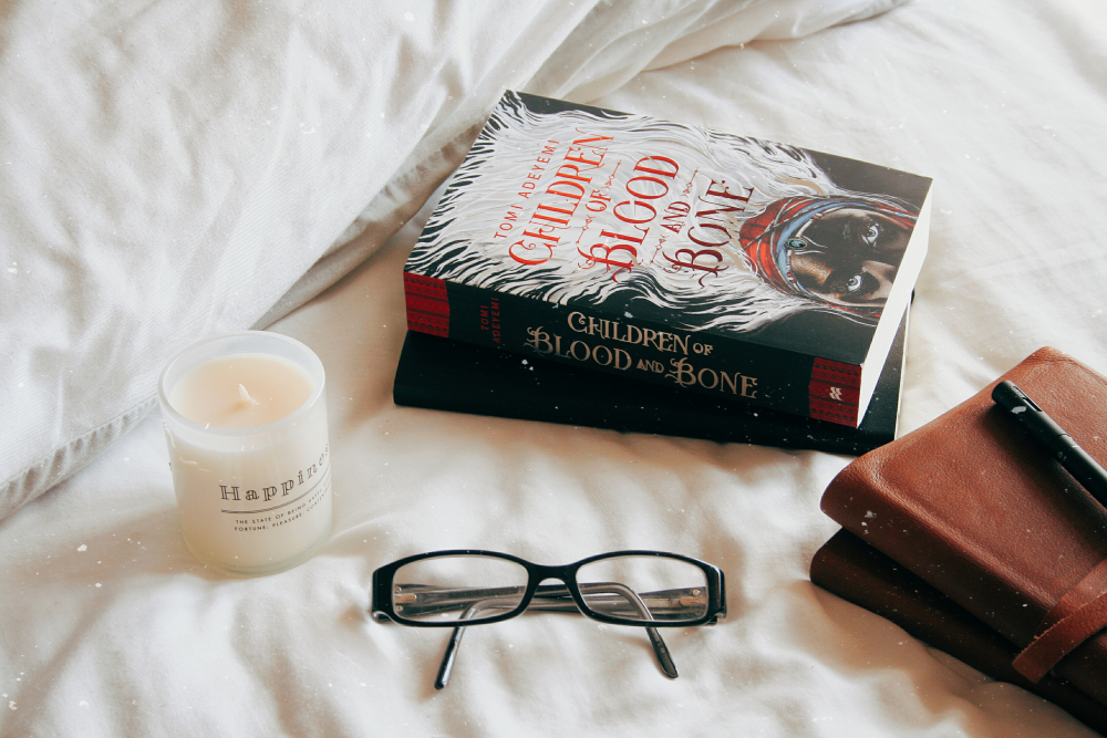 the book children of blood and bone on a bed