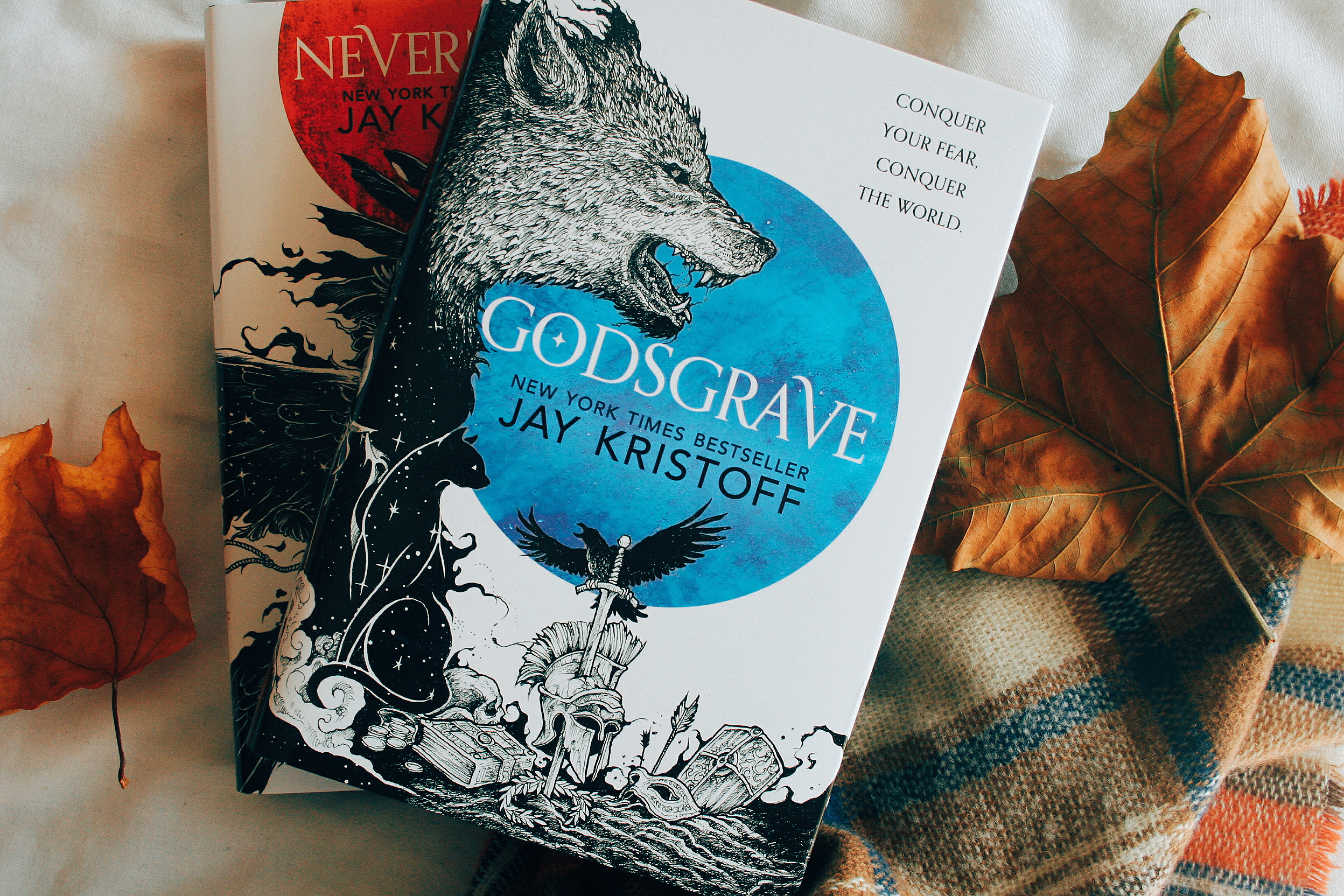 nevernight by jay kristoff on a bed with leaves
