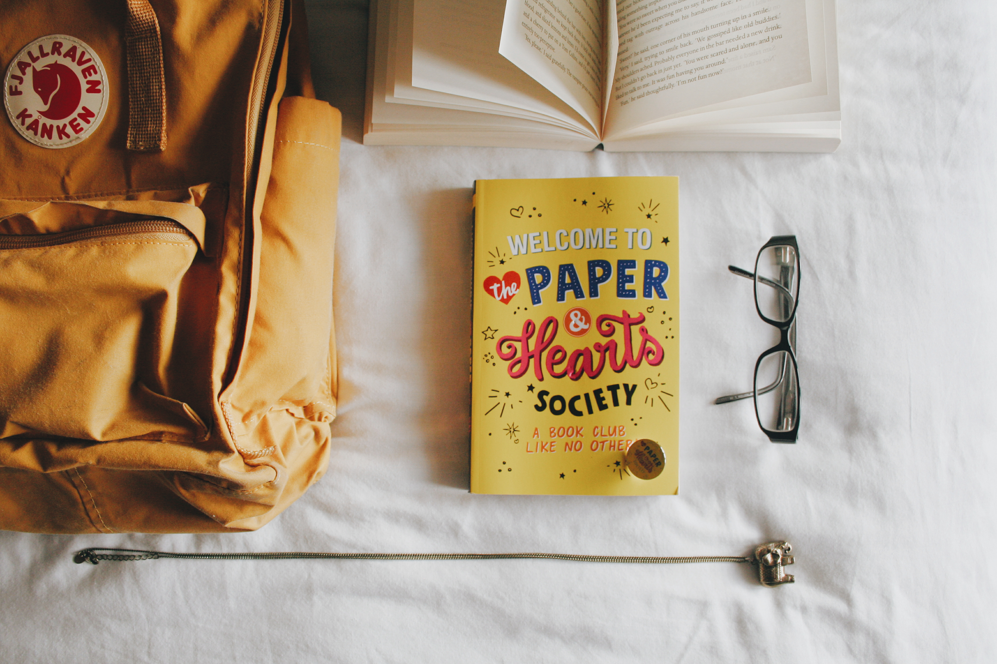Paper & Hearts Society book on bed