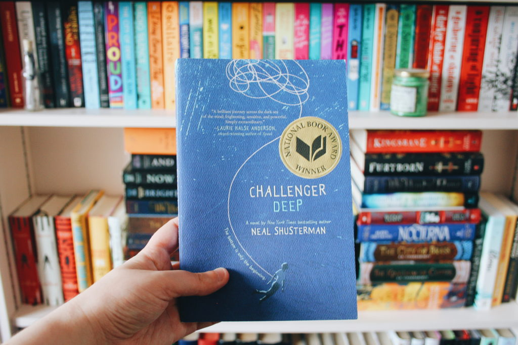 Challenger Deep book in front of a bookcase